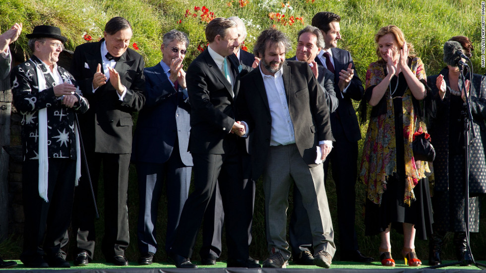 Actor Martin Freeman, left, is greeted by director Peter Jackson on stage with other cast members at the world premiere.