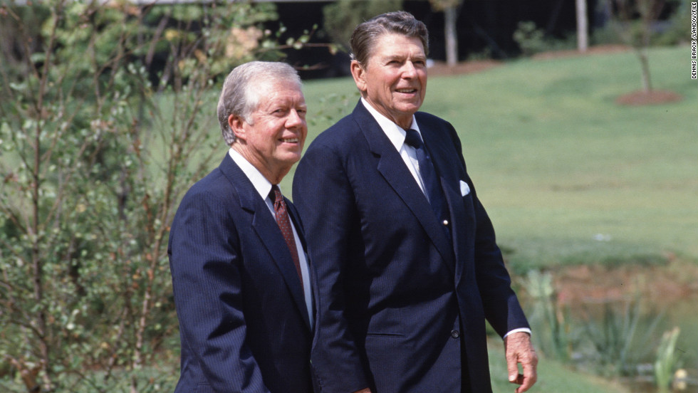 President Ronald Reagan attends the dedication ceremony for Jimmy Carter's presidential library in Atlanta in October 1986, nearly six years after Reagan had defeated him in his bid for a second term.