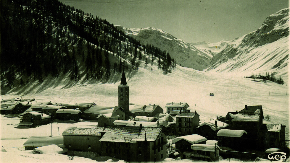 Val d'Isere is a small village that became an internationally renowned ski resort. This picture, from 1896, shows its humble origins, as a handful of homes cluster round its 11th century church.