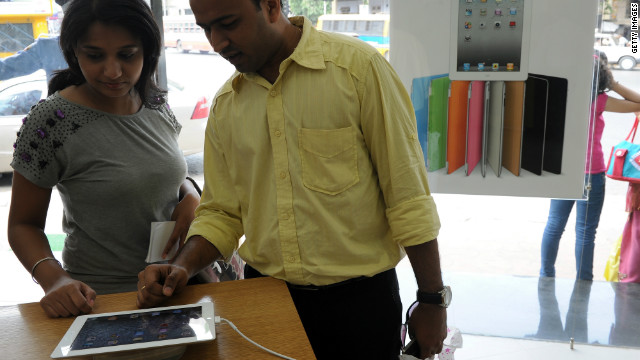 A couple in Mumbai, India, checks out the iPad 2 at an Apple reseller in 2011.