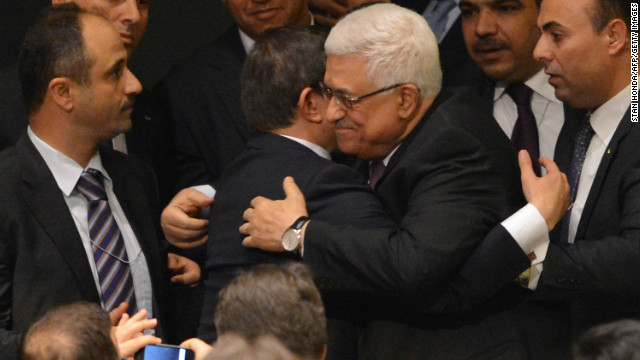 Palestinian Authority President Mahmoud Abbas (C) gets a hug from Ahmet Davutoglu, Turkey's Foreign Minister, as the Palestinians celebrate after the United Nations General Assembly voted to approve a resolution to upgrade the status of the Palestinian Authority to a nonmember observer state November 29, 2012 at UN headquarters in New York. AFP PHOTO/Stan HONDA (Photo credit should read STAN HONDA/AFP/Getty Images)