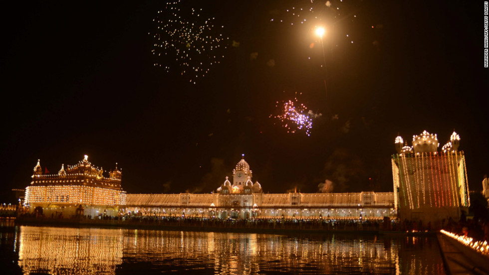 A fireworks display lights up the sky above the the illuminated Golden Temple, the religion's holiest shrine, in Amritsar, India, on Wednesday.