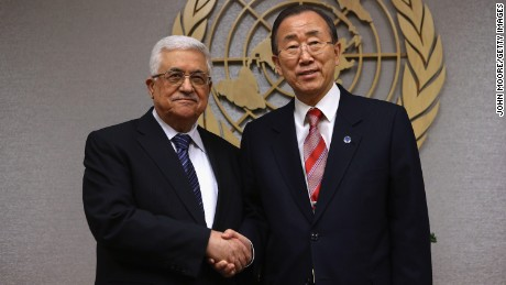 Mahmoud Abbas, President of the Palestinian National Authority, and United Nations Secretary General Ban Ki-moon pose for photos at UN headquarters on November 28, 2012 in New York City.
