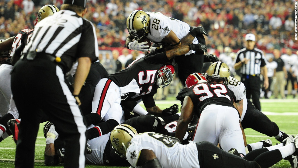 Mark Ingram of the New Orleans Saints scores a second quarter touchdown against the Atlanta Falcons on Thursday.