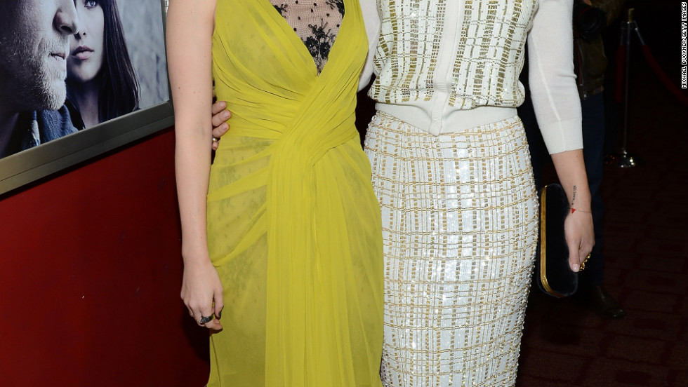 "Kate Mara and Olivia Wilde attend the Hollywood premiere of ""Deadfall."""
