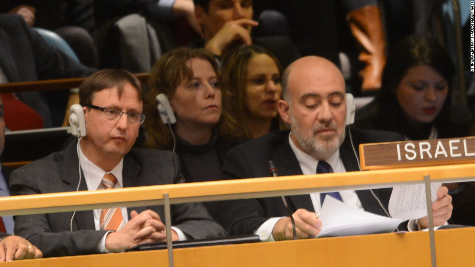Ron Prosor, right, Israeli ambassador to the United Nations, listens to the speech by Mahmoud Abbas.