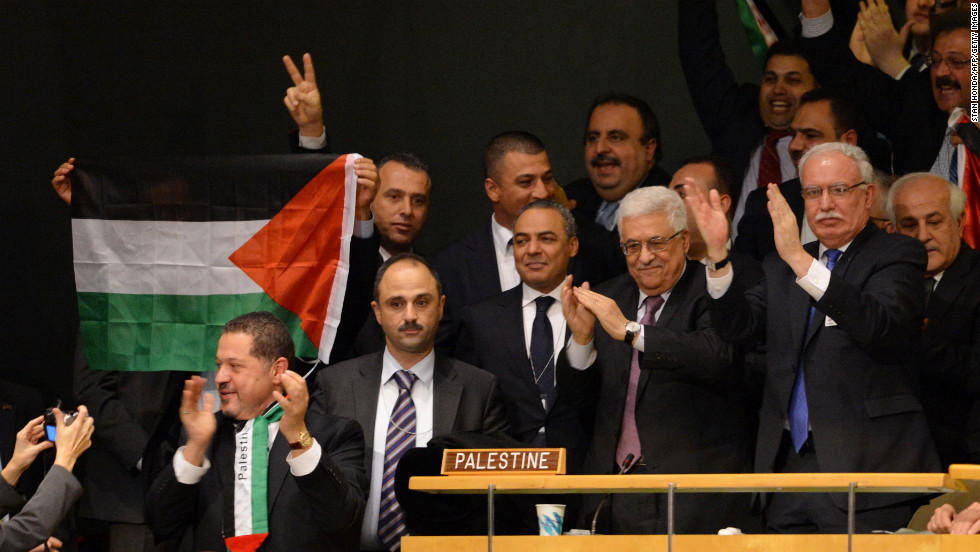 Mahmoud Abbas and the Palestinian delegates celebrate after the General Assembly votes to approve the resolution.