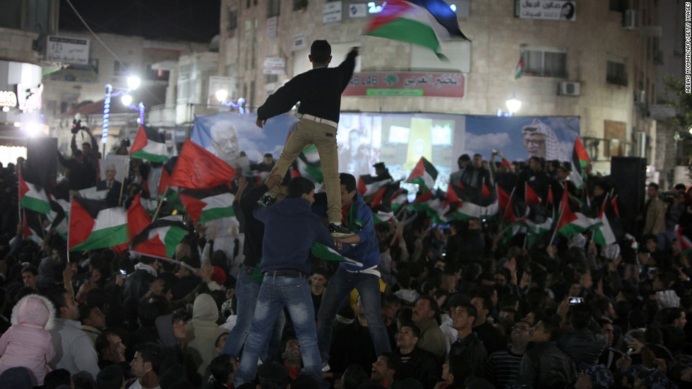 Palestinians celebrate in the West Bank city of Ramallah after hearing news of the successfully passed resolution at the General Assembly.