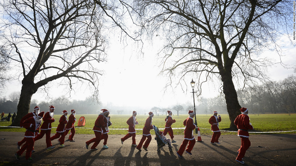Competitors run in the annual 6-kilometer Santa Run in Battersea Park, London, on December 1.