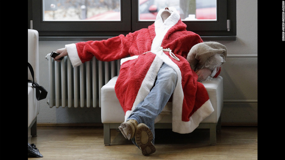 A volunteer Santa Claus takes a nap during the general meeting outlining guidelines for Father Christmases in Berlin on December 1.