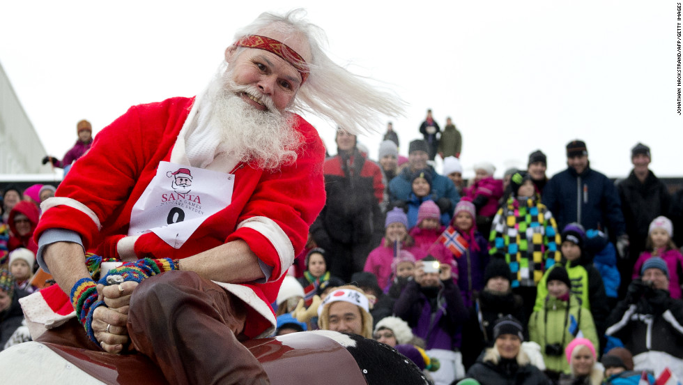 A Santa Claus representing the indigenous Sami people competes in the reindeer ride event during the Santa Claus Winter Games in Gallivare on November 17.