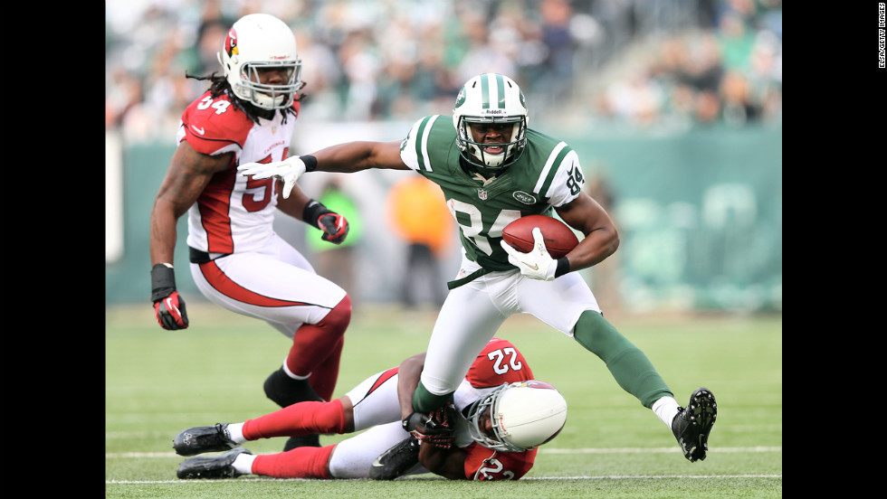 Stephen Hill of the New York Jets tries to get a few extra yards as Quentin Groves, left, and William Gay, bottom, of the Arizona Cardinals defend on Sunday.