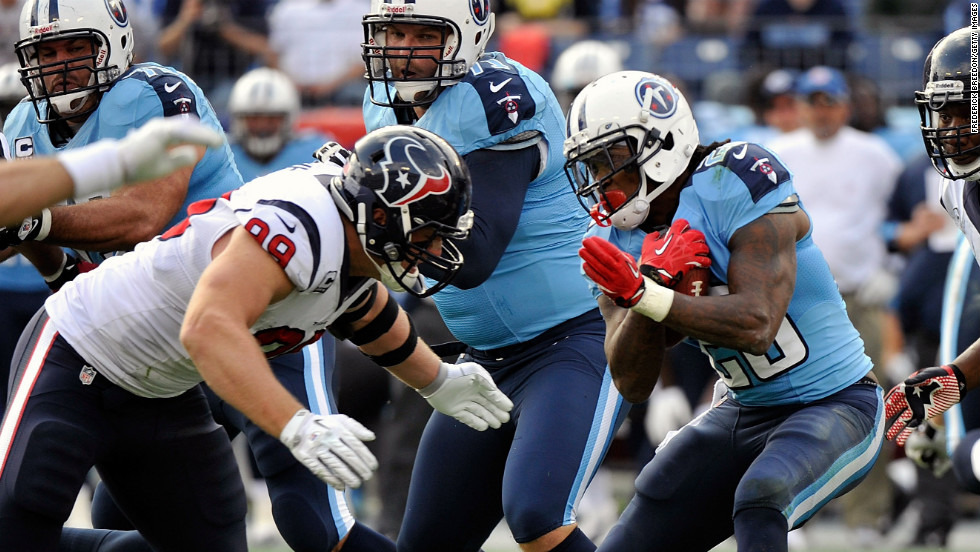 J.J. Watt of the Houston Texans tackles Chris Johnson of the Tennessee Titans on Sunday at LP Field in Nashville, Tennessee.