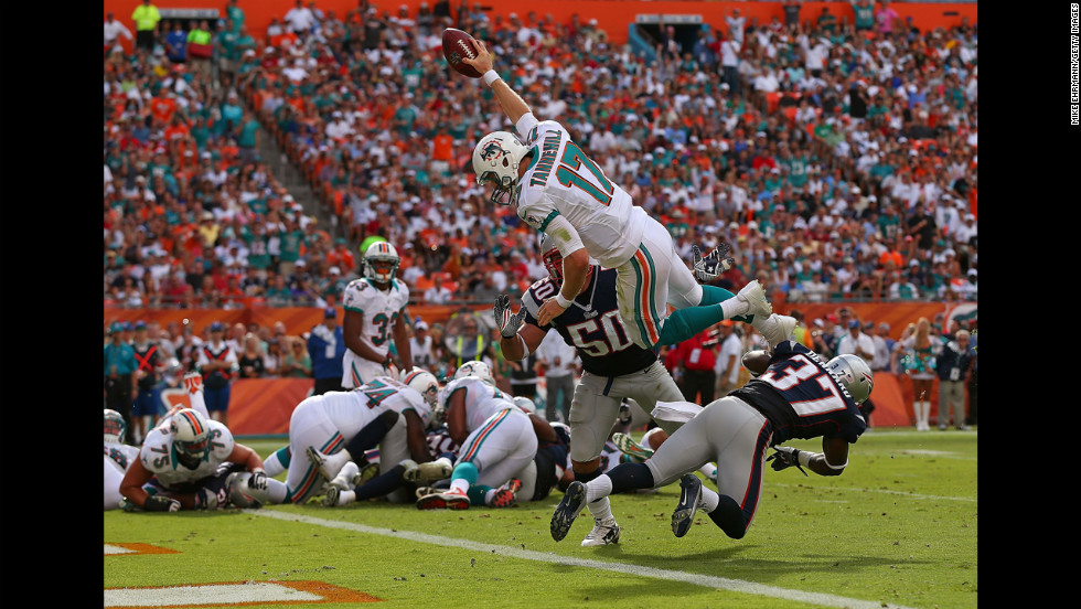 Ryan Tannehill of the Miami Dolphins dives for a touchdown against the New England Patriots at Sun Life Stadium on Sunday in Miami Gardens, Florida.