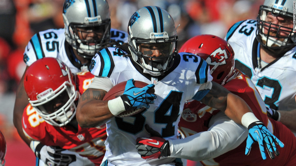 Running back DeAngelo Williams of the Carolina Panthers rushes up field against the Kansas City Chiefs on Sunday at Arrowhead Stadium in Kansas City, Missouri.