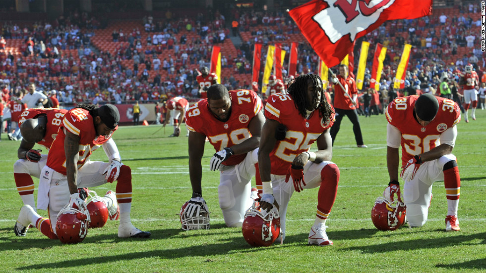The Kansas City Chiefs kneel and pray before a game against the Carolina Panthers on Sunday, December 2, 2012 at Arrowhead Stadium in Kansas City, Missouri.