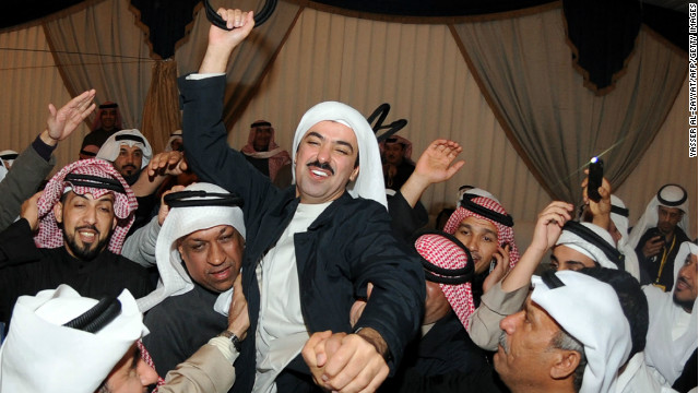 Kuwaiti former MP and candidate Ali al-Rashed (C) celebrates following his victory in the parliamentary elections in Kuwait City.
