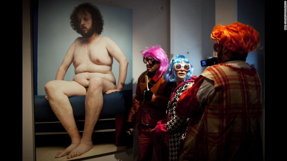 <strong>February 20: </strong>Israeli students wearing costumes visit an art exhibition in downtown Jerusalem. The special cultural project aimed to draw people out in spite of the cold weather to enjoy art in a party atmosphere.