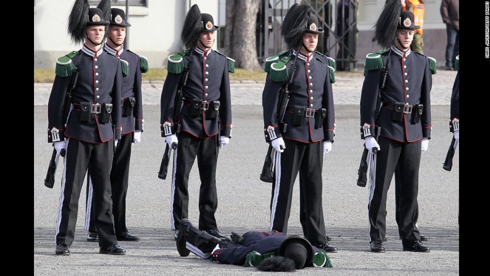 <strong>March 20: </strong>A soldier faints as Camilla, Duchess of Cornwall, and Prince Charles, Prince of Wales, arrive for a wreath-laying ceremony at the National Monument at Akershus Fortress in Olso, Norway. The royals were on a Diamond Jubilee tour of Scandinavia.