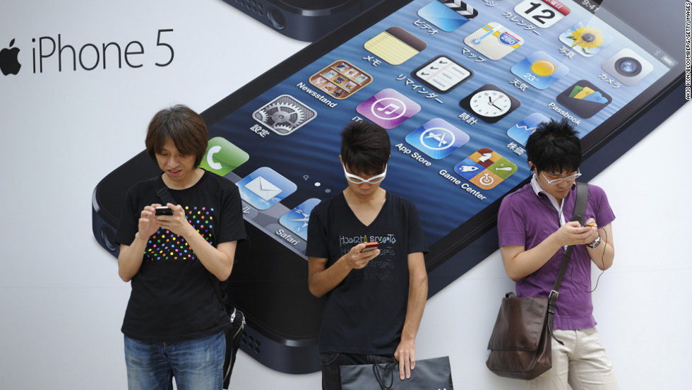 <strong>September 21:</strong> People stand outside a store in Tokyo before the launch of the iPhone 5. Based on first-day orders, the iPhone 5 became the fastest-selling device Apple has released.
