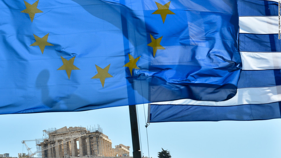 <strong>October 12:</strong> The European Union wins the Nobel Peace Prize while grappling with the worst crisis since its founding -- devastating debt and the threat of disintegration. The flag of the 27-nation union, left, flies alongside the flag of debt-ridden Greece in front of the Acropolis in central Athens.