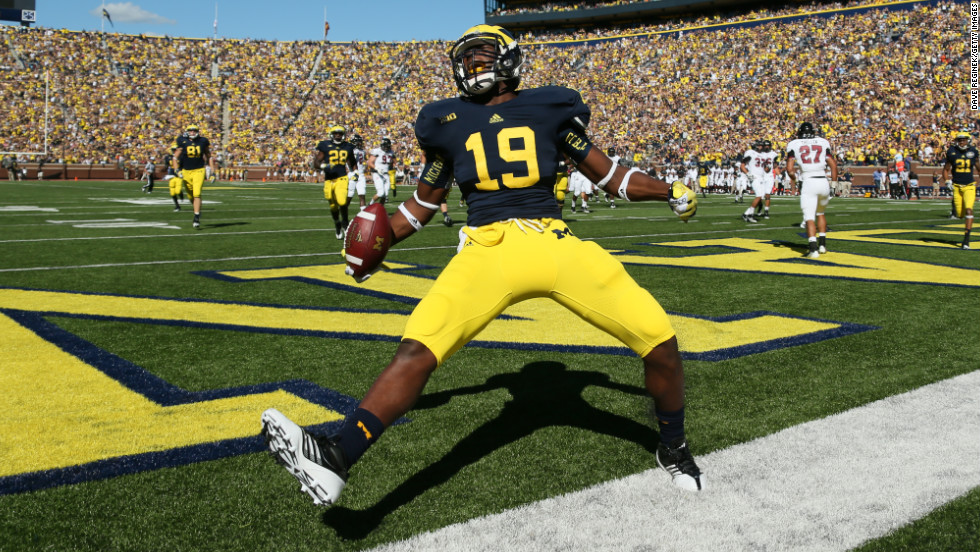Devin Funchess of the University of Michigan celebrates after scoring a touchdown against the University of Massachusetts Minutemen on September 15 at Michigan Stadium in Ann Arbor, Michigan.