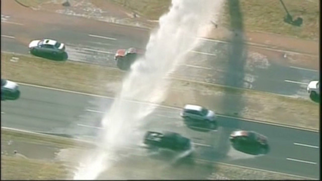 Water main break douses expressway