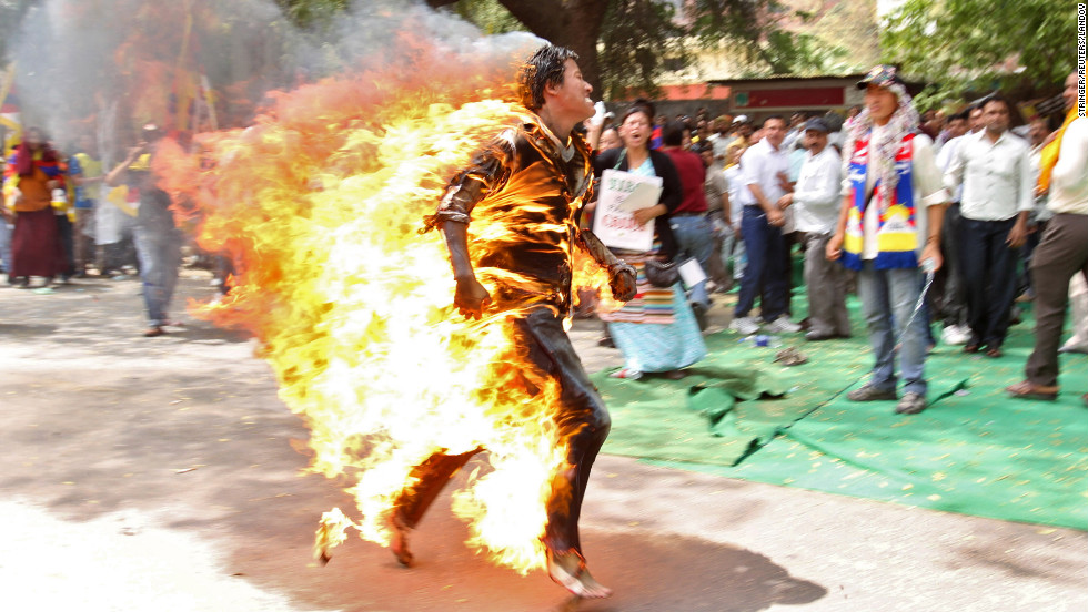 <strong>March 26: </strong>A Tibetan exile runs after setting himself on fire in New Delhi, India, during a protest against Chinese President Hu Jintao's upcoming visit.