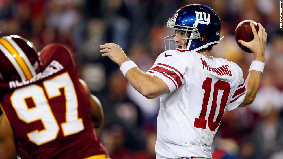 Giants quarterback Eli Manning throws the ball in the first quarter of the game against the Redskins.