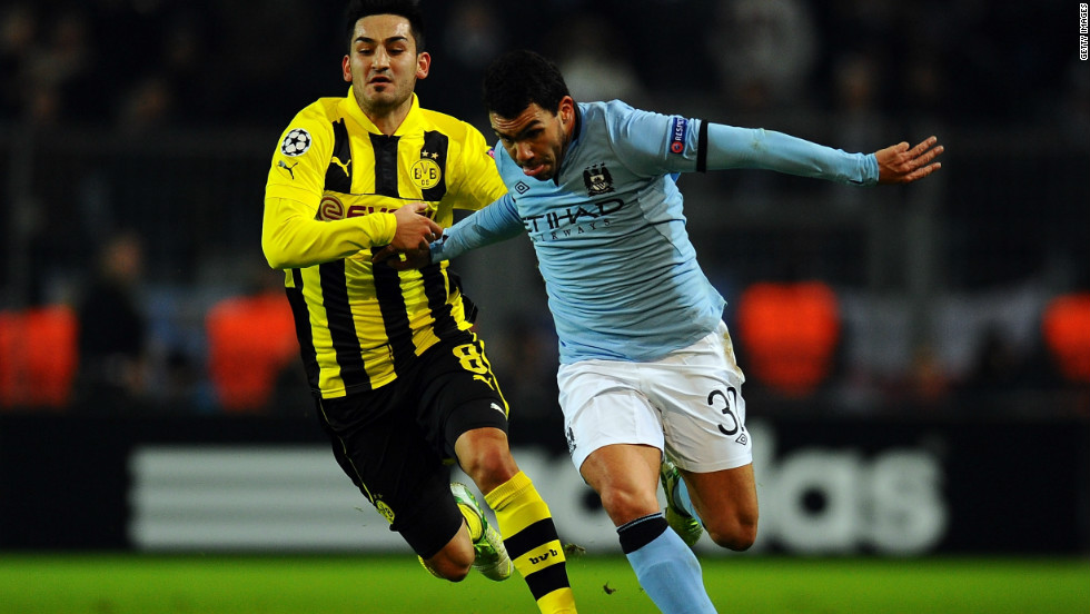 Carlos Tevez takes on Ilkay Guendogan of Borussia Dortmund during a frustrating night for Manchester City as it crashed out of European competition with a 1-0 defeat. City becomes the first English team to have failed to win a single group game in the compeititon.