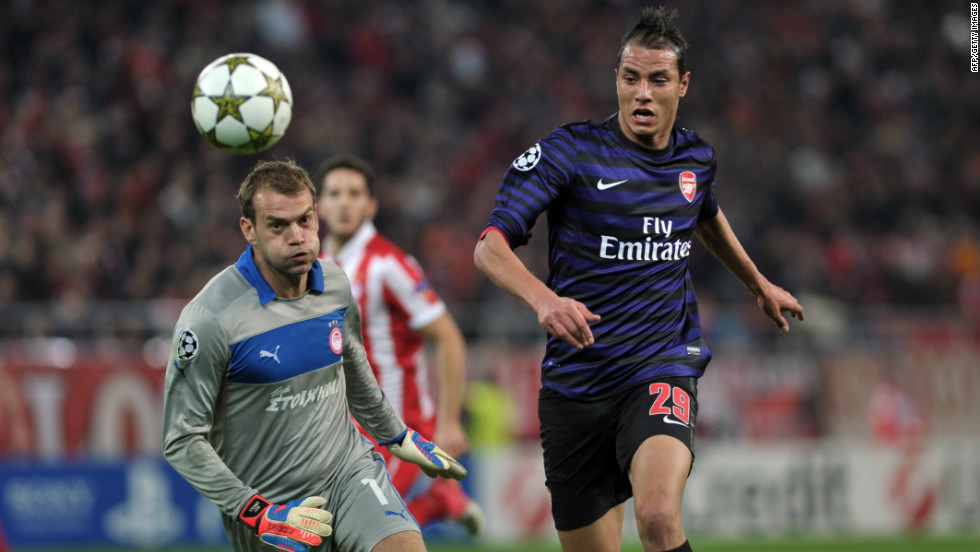Arsenal's Marouane Chamakh endured a disappointing night as the Gunners were beaten 2-1 by Olympiakos in Greece. Tomas Rosicky's effort had given Arsenal the lead but strikes from Giannis Maniatis and Kostas Mitroglou gave the Greek side victory.
