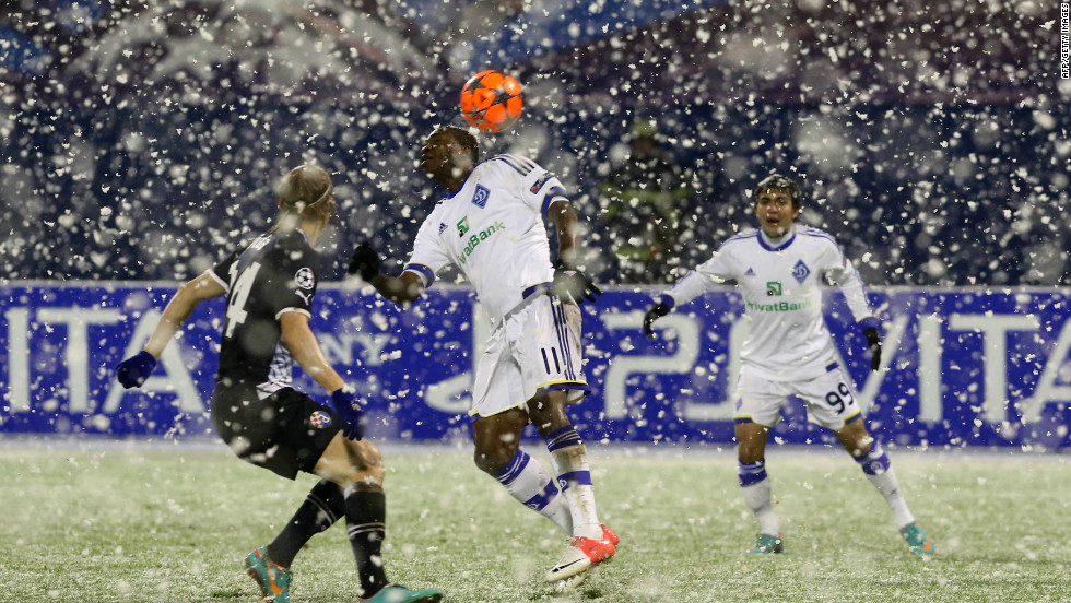 Dynamo Kiev's Ideye Brown fights for the ball with Dinamo Zagreb's Domagoj Vida in a game which was halted after 11 minutes following a snow storm in Croatia. The teams returned to the field after a 17 minute delay and played out a 1-1 draw