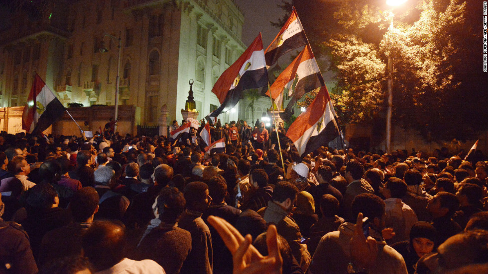 Tens of thousands of demonstrators encircled the presidential palace in Cairo after riot police failed to keep them at bay with tear gas on December 4.