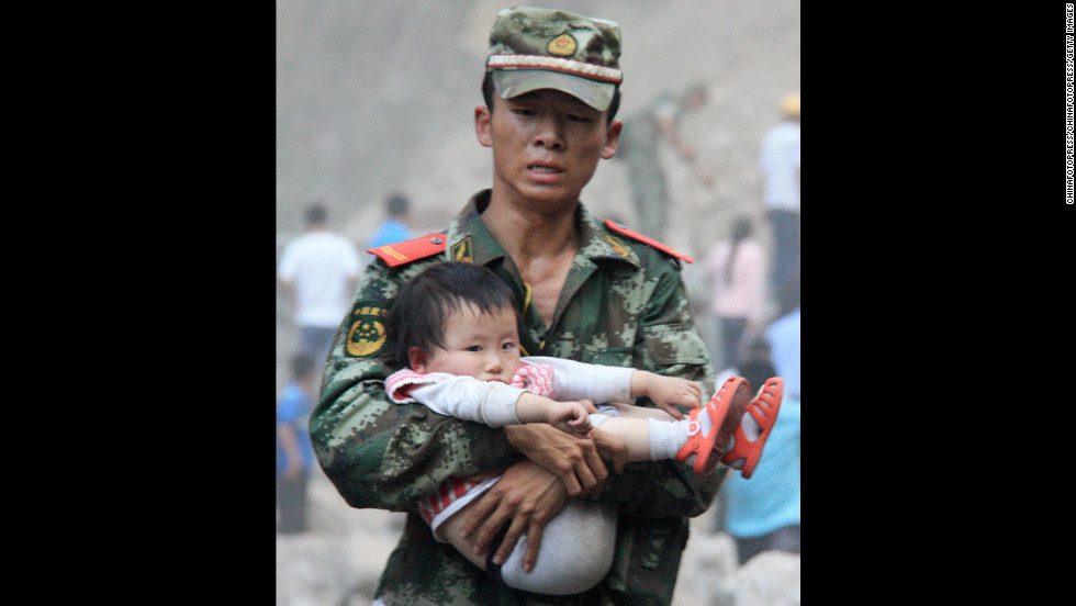 <strong>September 9: </strong>A rescue worker carries a child in Yiliang County, China. At least 80 people were killed and more than 800 others were injured after two earthquakes jolted southwest China.