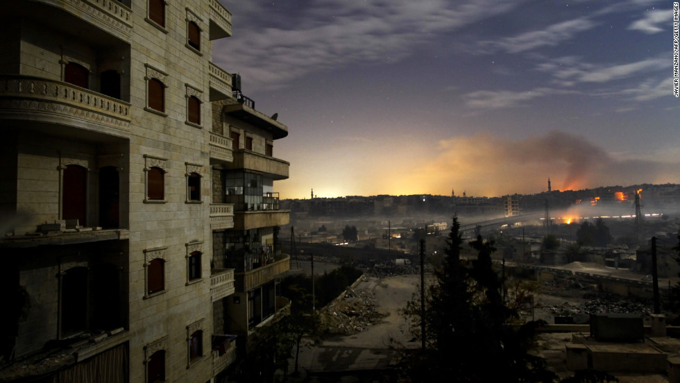 Smoke rises from fighting in the Hanano and Bustan al-Basha districts of  Aleppo on Saturday, December 1.
