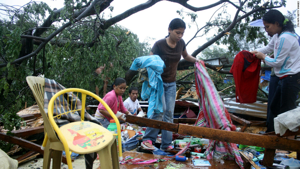 Residents gather their belongings after their house was destroyed by strong winds brought about by the storm in Cagayan de Oro City, on the southern island of Mindanao, on Tuesday, December 4.