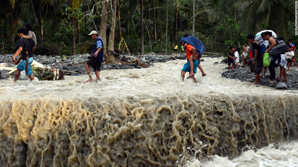 Residents cross a road destroyed at the height of Typhoon Bopha in the village of Andap, New Bataan township, Compostela Valley province on December 5.