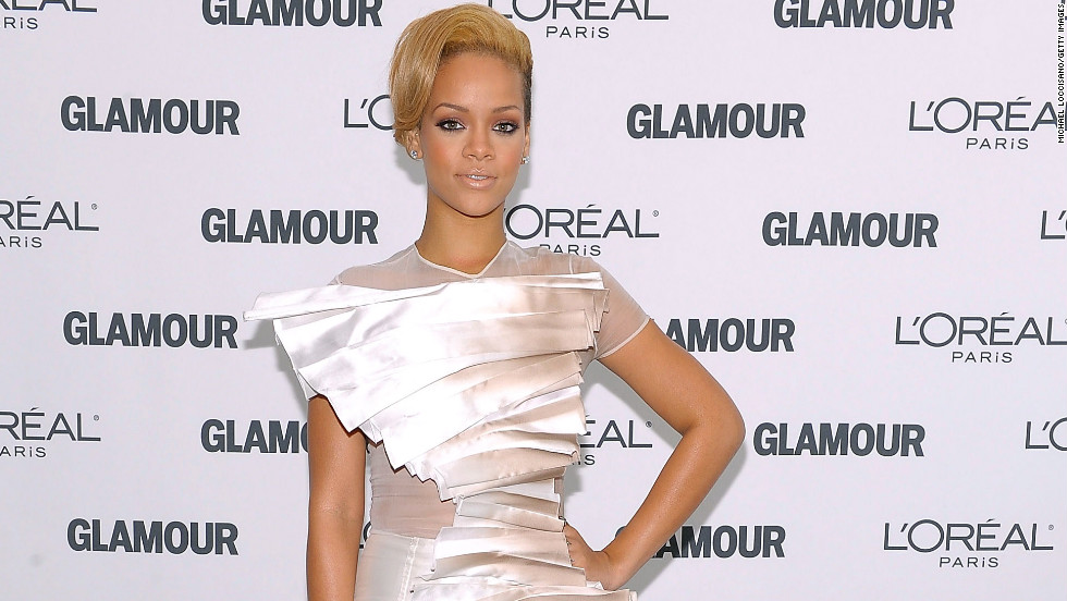 Wearing a white gown, Rihanna attends a 2009 event hosted by Glamour magazine in New York City.