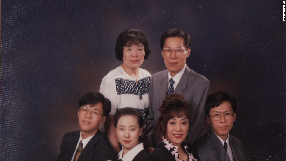 "Sumi Jo (front row, second from right) with her parents and other family members. She was in Paris performing when her father died and missed his funeral because her mother persuaded her to stay and ""sing for your public."""