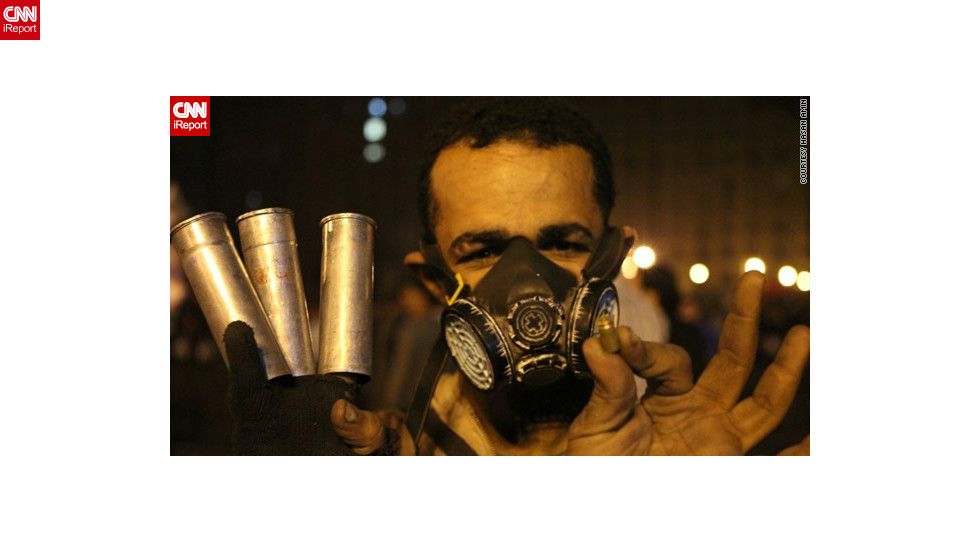 "An anonymous protester holds empty tear gas canisters and a shell casing in this photo by <a href=""http://ireport.cnn.com/docs/DOC-885571"">iReporter Hasan Amin</a> at a demonstration that turned violent on November 24. Protests began shortly after Morsy announced his powers extension on November 22."