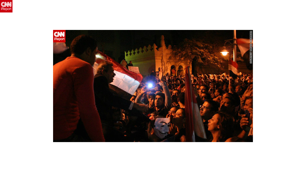 "By December 4, protests had gotten larger and anti-government demonstrators <a href=""http://ireport.cnn.com/docs/DOC-891041"">marched on the presidential palace</a> in Cairo, as seen in this image by iReporter Maged Eskander. Crowds shouted ""liar"" in reference to Morsy and chanted anti-Muslim Brotherhood slogans."