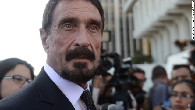 US anti-virus software pioneer John McAfee (L) listens to questions from a journalist in front of the Supreme Court in Guatemala City on December 04, 2012. McAfee, wanted for questioning over the murder of his neighbor last month in Belize, is seeking political asylum in Guatemala. AFP PHOTO / Johan ORDONEZJOHAN ORDONEZ/AFP/Getty Images