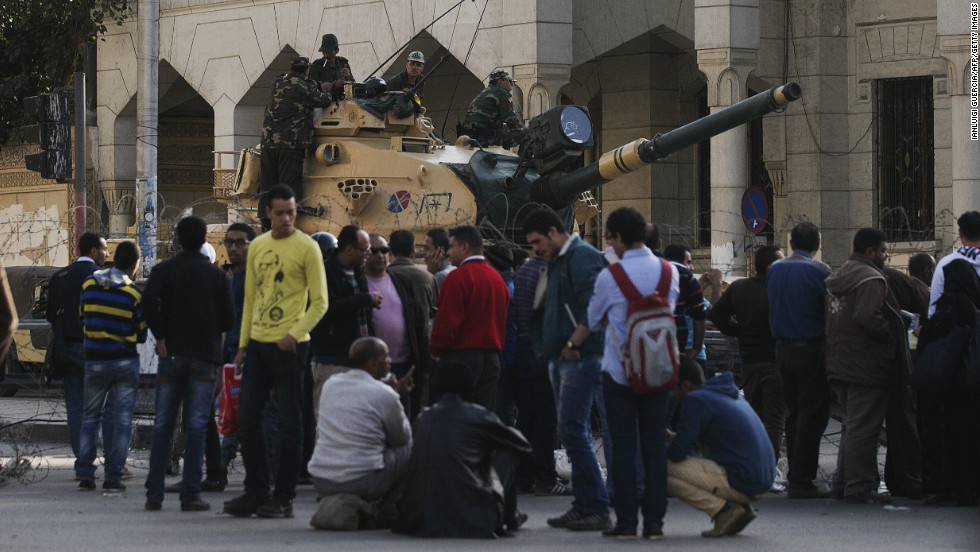 Protesters are blocked from approaching the the presidential palace by the Egyptian army on December 6 in Cairo.