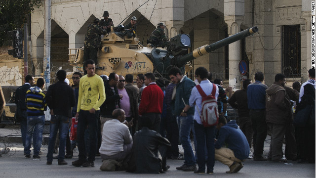 Protestors are blocked from approaching the the presidential palace by an Egyptian army road block.