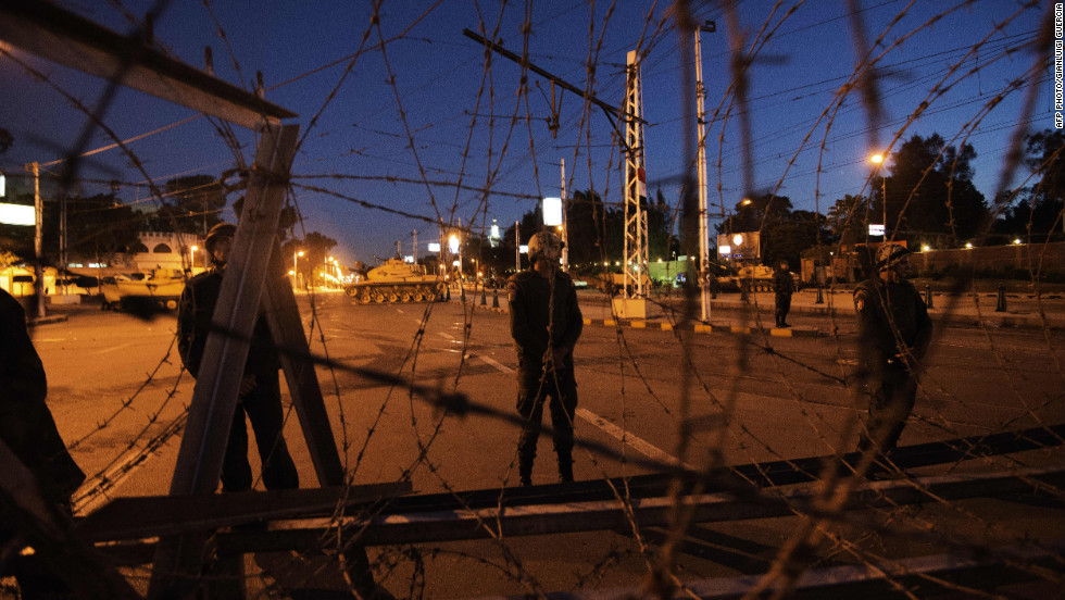 Egyptian soldiers stand outside the presidential palace in Cairo after setting up barbed wire barricades on December 6.