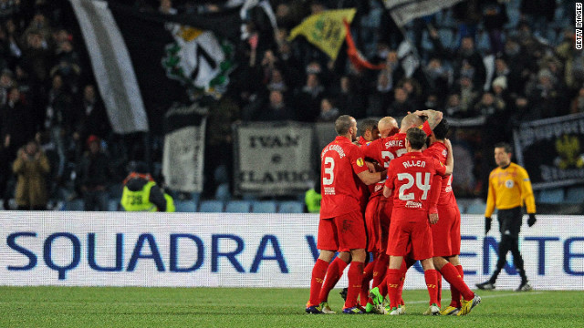 Liverpool's Jordan Henderson is mobbed after scoring the decisive goal in the 1-0 win over Udinese in Italy.