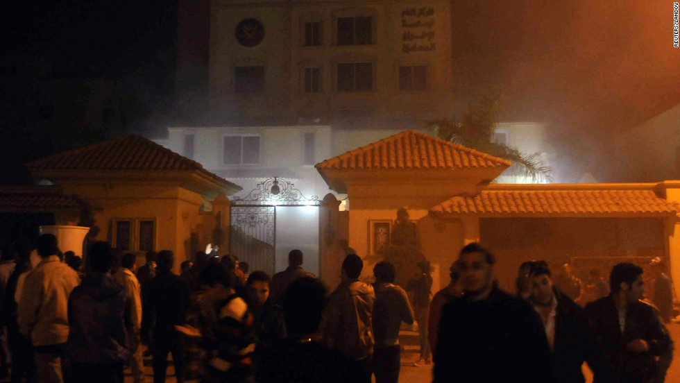 Protesters angry over Morsy's decisions giving himself unchecked powers surround the Muslim Brotherhood's headquarters in Cairo after starting a fire inside the compound on Thursday, December 6.
