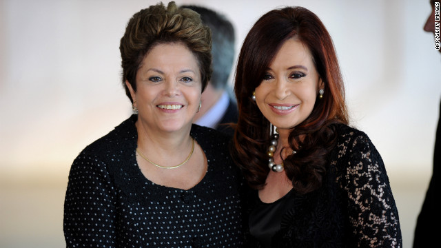 Brazilian president Dilma Rousseff and her Argentina's counterpart Cristina Fernandez de Kirchner greet each other as they arrive at the Summit of Heads of State of Mercosur and Associated States, at Itamaraty Palace, Brasília, Brazll, on December 07, 2012