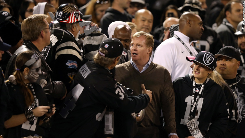 "NFL commissioner Roger Goodell stands with fans in the ""Black Hole"" during the game between the Oakland Raiders and the Denver Broncos on Thursday."