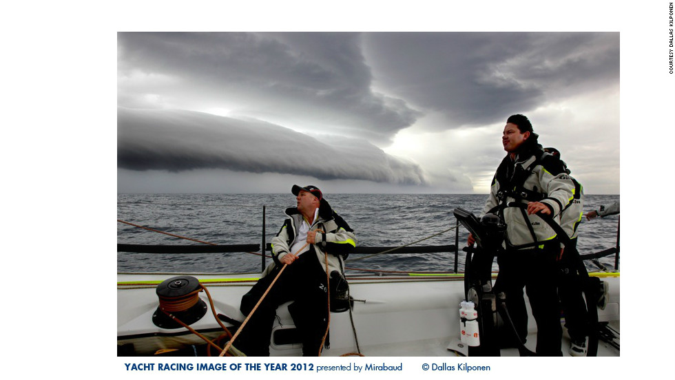 Sailors brace for a storm during the Rolex Sydney to Hobart Yacht Race in this photo by Dallas Kilponen.